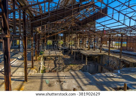 Ruins of an abandoned old factory. The remains of the steel structure. - stock photo