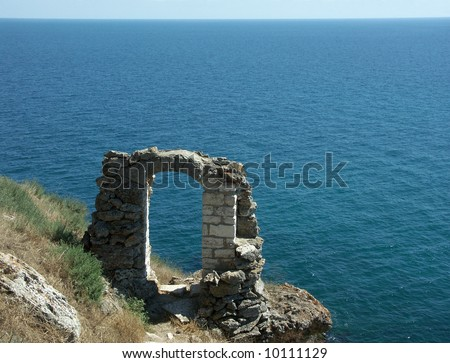 Ruins of an ancient stone arch (Kaliakra - Bulgaria). More photos in my gallery. - stock photo