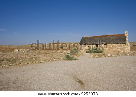 Ruins of an old Restored stone farm house in the Kalahari - stock photo
