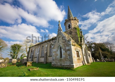 Ruins of ancient abandoned church with graveyard in Ireland - stock photo