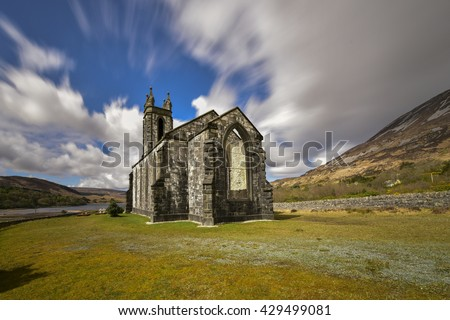 Ruins of ancient abandoned church with graveyard in Ireland, Poisen Glen - stock photo