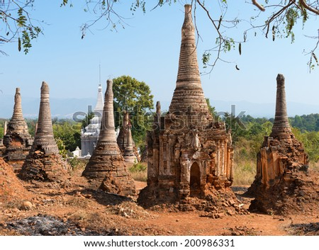 Ruins of ancient Burmese Buddhist pagodas Nyaung Ohak in the village of Indein on Inlay Lake in Shan State, Myanmar (Burma). - stock photo