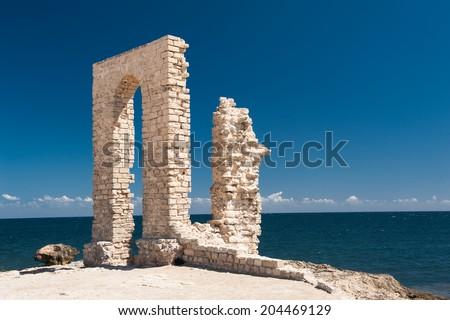 Ruins of ancient Fatimid fortifications from the 10th century by the sea in Mahdia, Tunisia - stock photo