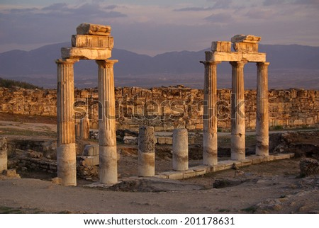 Ruins of ancient Hierapolis at sunset, Pamukkale. Turkey