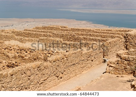 Ruins of ancient Masada fortress in the desert near the Dead Sea - stock photo