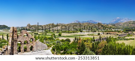 Ruins of ancient Roman aqueduct in Aspendos near Antalya, Turkey - stock photo