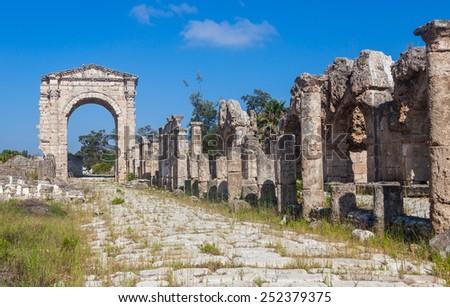 Ruins of ancient Roman Triumphal Arch, Tyre, Lebanon - stock photo