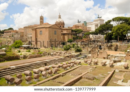 Ruins of Ancient Rome at the Roman forum in Italy - stock photo