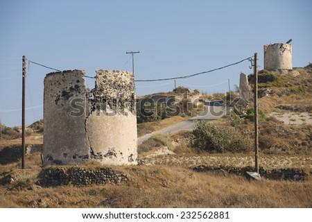 Ruins of ancient windmills at Santorini, Greece. - stock photo
