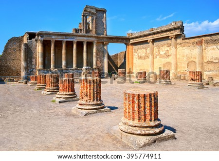 Ruins of antique roman temple in Pompeii, destroyed by eruption of Mount Vesuvius volcano in 79 AD, Naples, Italy - stock photo