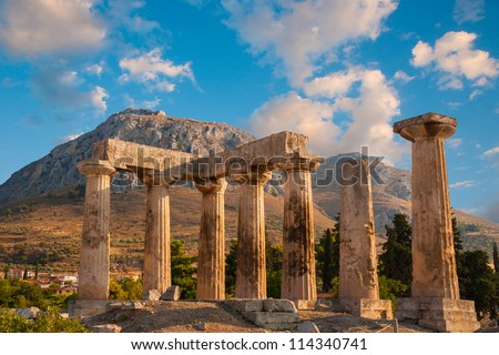 Ruins of Appollo temple with fortress at back in ancient Corinth, Greece - stock photo