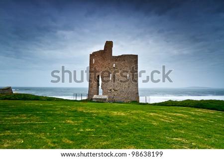 Ruins of Ballybunion castle on the coast of Atlantic ocean, Ireland - stock photo