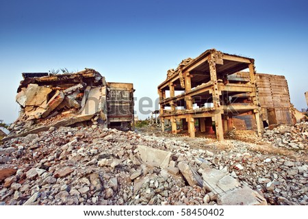 Ruins of buildings after an earthquake - stock photo