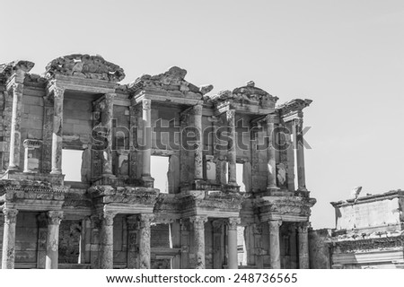 Ruins of Celsus Library in ancient Greek city Ephesus, Turkey. Black and white - stock photo