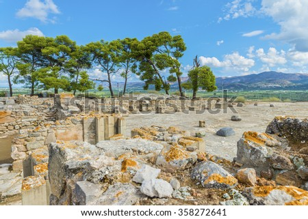 Ruins of central square of the ancient Minoan Palace of Phaistos ( Festos ). Located at plateau Messara.Beautiful natural and architectural landscape. District of Heraklion.Crete island.Greece.Europe. - stock photo