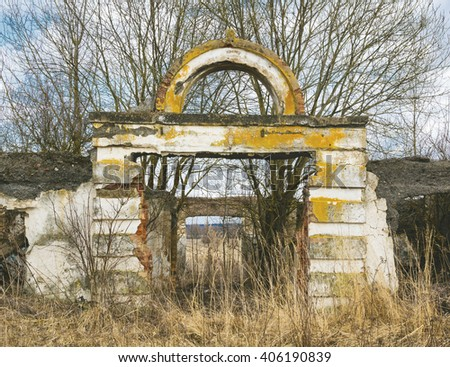 Ruins of collective farm buildings in russian countryside - stock photo