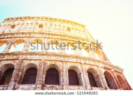 ruins of Colosseum, close up details of facade with sunshine, Rome Italy