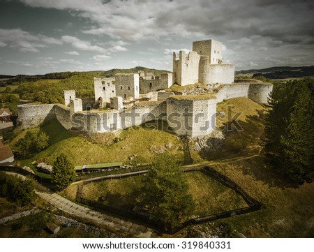 Ruins of gothic castle Rabi in National Park Sumava. Aerial view to medieval monument in Czech Republic. Central Europe. Retro style filtered picture. - stock photo
