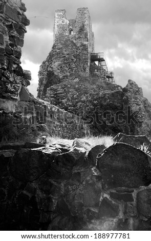 Ruins of gothic castle Trosky in Czech Republic. Black and white photo. - stock photo