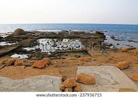 Ruins of Herods promontory palace pool in Caesarea Maritima National Park, a city and harbor built by Herod the Great about 25-13 BC. The archaeological ruins are on the Mediterranean coast of Israel. - stock photo