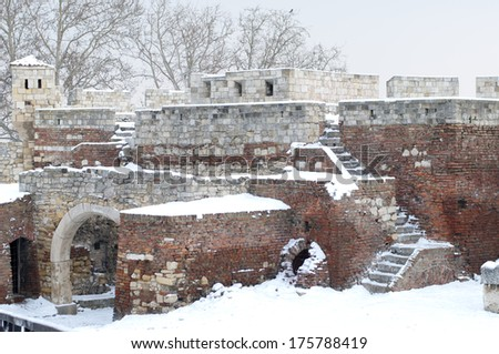 Ruins of medieval walls of the old fortress of Kalemegdan in Belgrade during winter time - stock photo