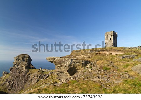Ruins of old castle on Cliffs of Moher - Ireland - stock photo