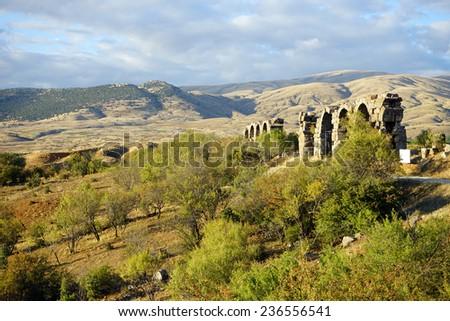 Ruins of roman aqueduct near Yalvac, Turkey                                - stock photo
