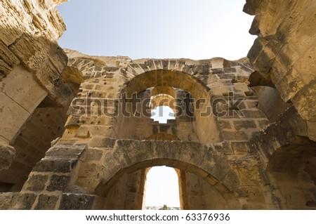 Ruins of Roman Colosseum in Tunisia - stock photo