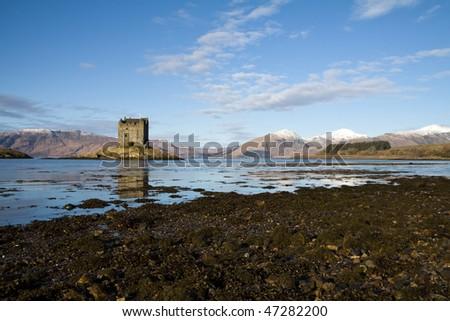 Ruins of Stalker Castle on a small island in Loch Linnhe, Scotland - stock photo