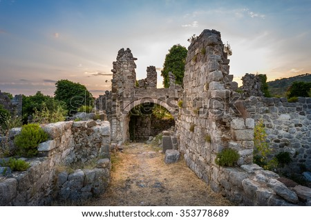 Ruins of Stari Bar ancient fortress, arch way to ruined defense tower, Montenegro.