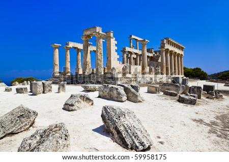 Ruins of temple on island Aegina, Greece - archaeology background - stock photo