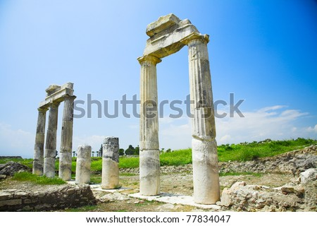 ruins of the ancient columns and arch - stock photo