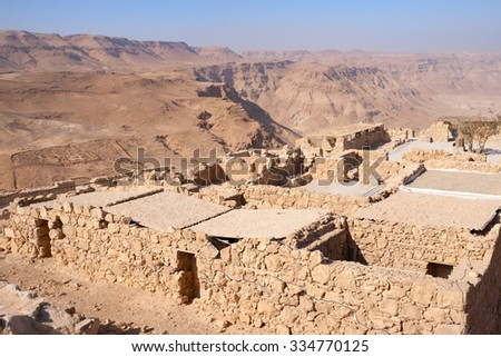 Ruins of the ancient Masada fortress in the Negev desert, Israel - stock photo