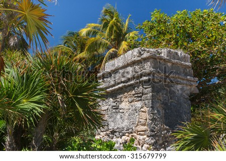 Ruins of the ancient Mayan city of Xcaret, Mexico - stock photo