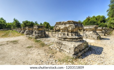 Ruins of the ancient site of Olympia, in Greece, where the Olympic games originate from. - stock photo