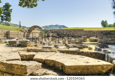 Ruins of the ancient site of Olympia, where the Olympic games originate from. - stock photo
