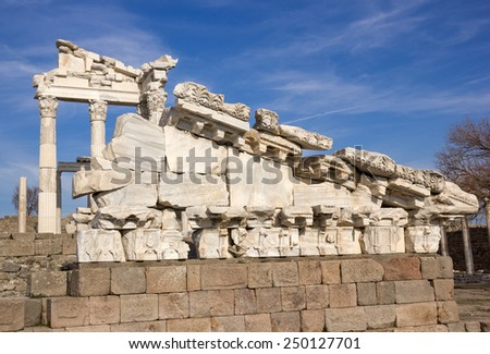 Ruins of the ancient temple (fragment of ruined fronton) of Trajan in Bergama Acropolis, Turkey - stock photo