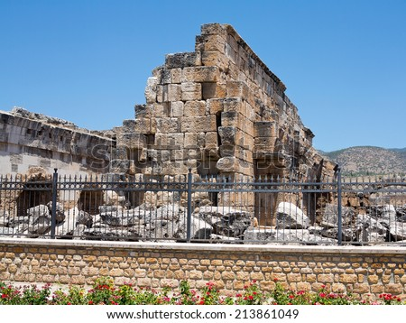 Ruins of the ancient temple in Hierapolis and blue sky, Denizli, Turkey