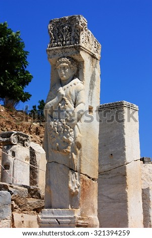 Ruins of the ancient town of Ephesus in Turkey, a statue on Kuretes Street in Celsus - stock photo