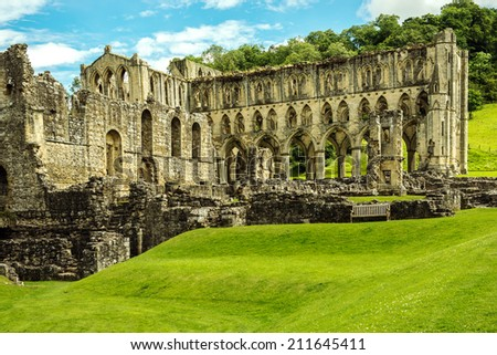 Ruins of the Cistercian Rievaulx Abbey near Helmsley in North Yorkshire, England - stock photo