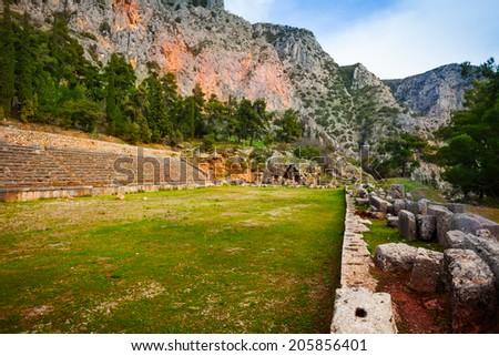 Ruins of the Greek ancient stadium, Delphi - stock photo
