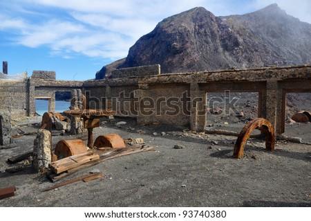 Ruins of the sulphur mines on White Island, NZ - stock photo