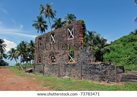 Ruins of the workshop on isle Royale, French Guiana. In this building, manual work had been carried on by the prisoners in order to make tools as well as anything else useful to the penal colony. - stock photo