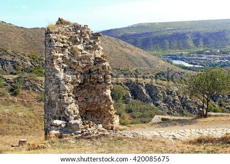 Ruins of tower of Jvari Monastery, a sixth century Georgian Orthodox monastery near Mtskheta, eastern Georgia - stock photo