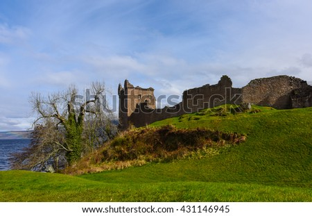 Ruins of Urquhart Castle along Loch Ness, Scotland - stock photo