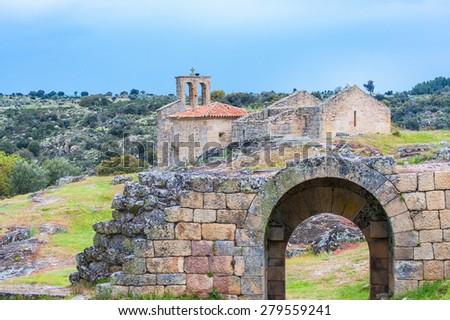 Ruins of XIII century Romanesque style church, Igreja de Santa Maria do Castelo in historical village Castelo Mendo in Portugal - stock photo