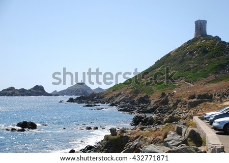 Ruins, overlooking the sea, creating a nice scenery. Beautiful day on Corsica Island, France - stock photo