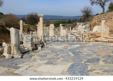 Ruins tumbles over along the  marble walkway in Ephesus, Turkey in the Middle East