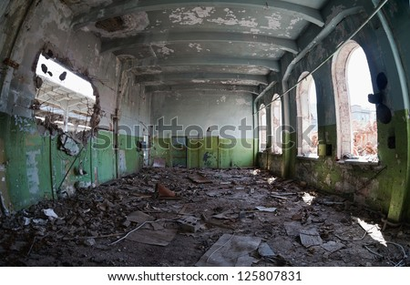 Ruins, view of an old abandoned factory building - stock photo