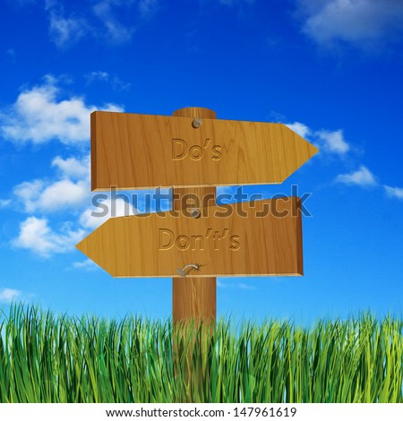 Rule concept with do's and don'ts on wooden sign board - stock photo